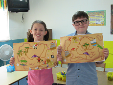 Two of our kiddos showing off their completed maps.